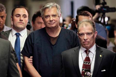 In this June 27, 2019 file photo, Paul Manafort, center, arrives at court in New York. (AP Pho ...