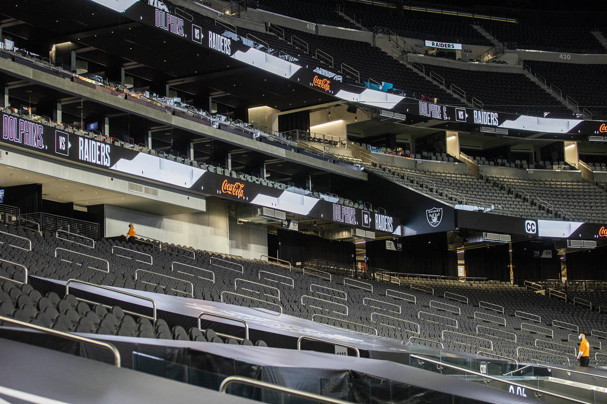 The seats at Allegiant Stadium are filled with a single usher during an NFL football game betwe ...