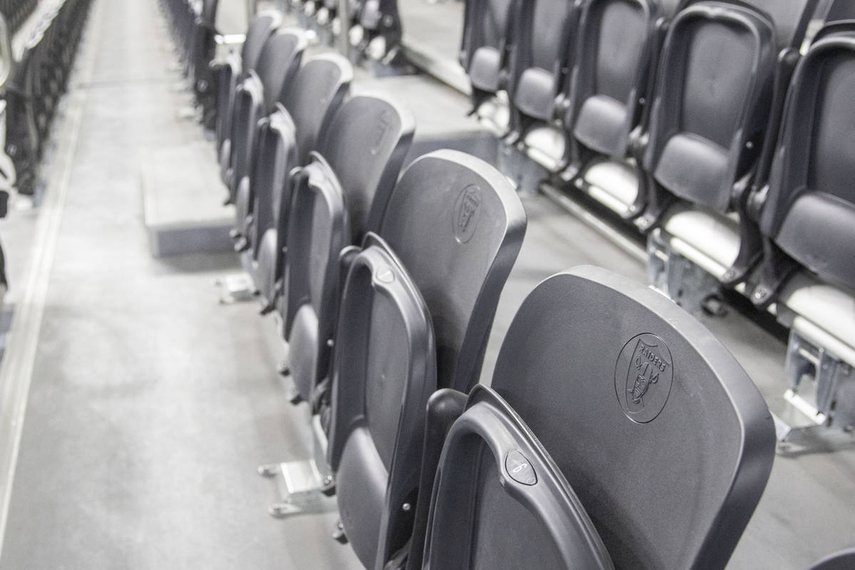 The Raiders logo is seen on empty seats during the fourth quarter of an NFL football game betwe ...