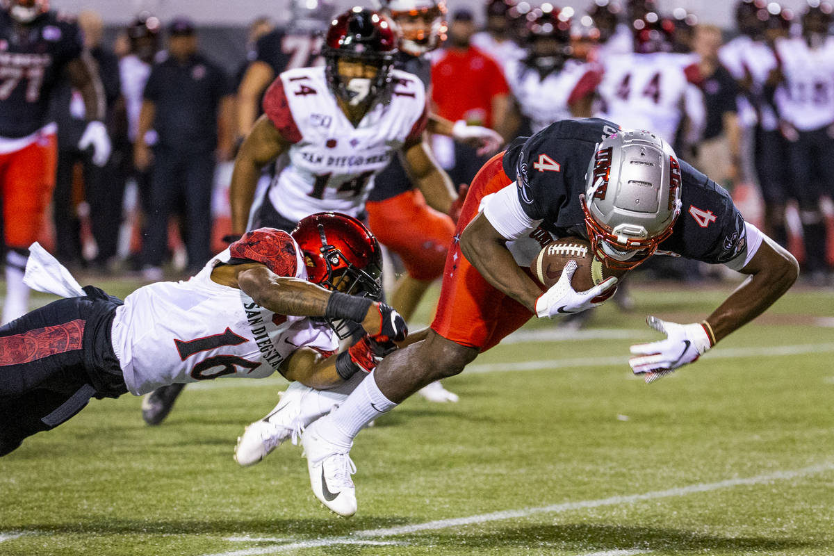San Diego State Aztecs cornerback Luq Barcoo (16, left) is able to trip up UNLV Rebels wide rec ...