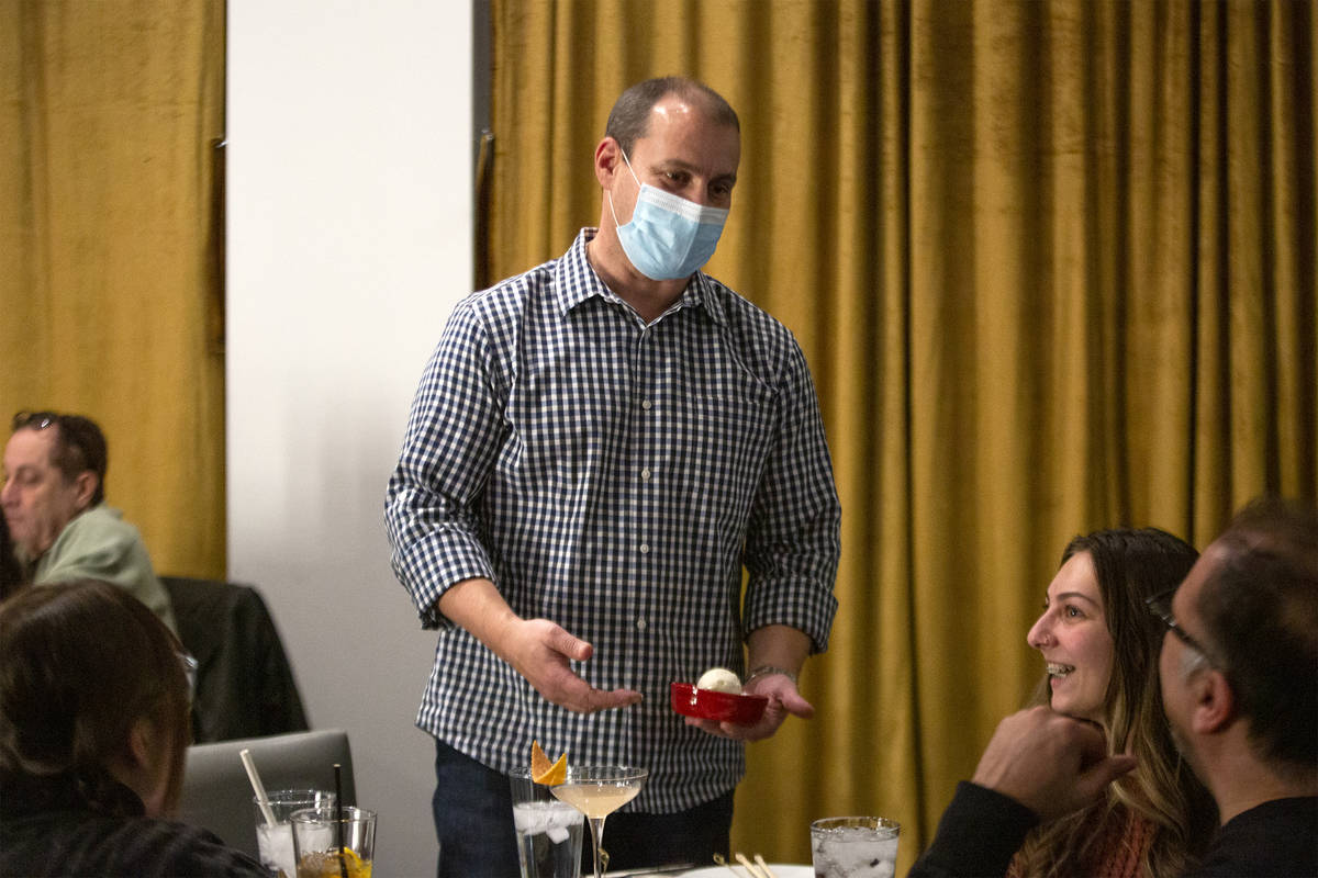 Co-owner of Chinglish Cantonese Wine Bar Ken Heck delivers a dessert to a group of diners on Th ...