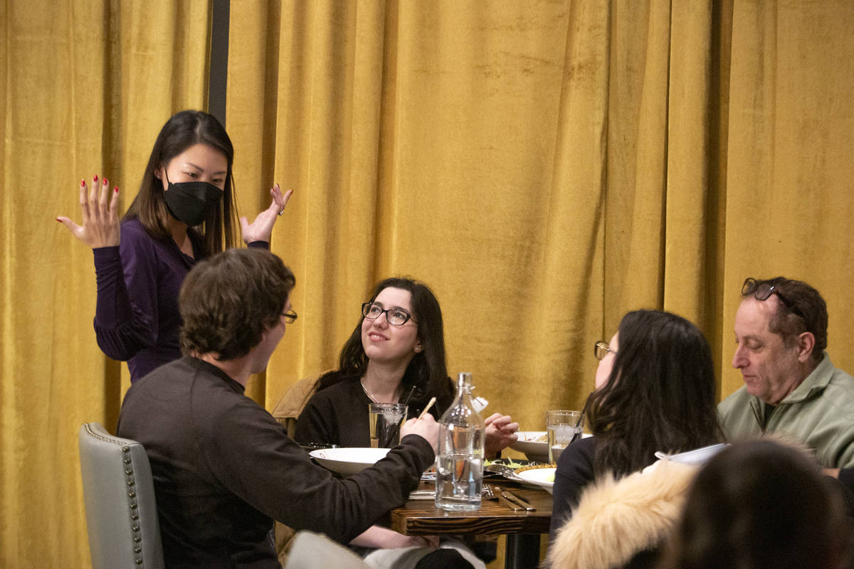 Brianna Winner, center, and her family chat with Chinglish Cantonese Wine Bar co-owner Kitty He ...