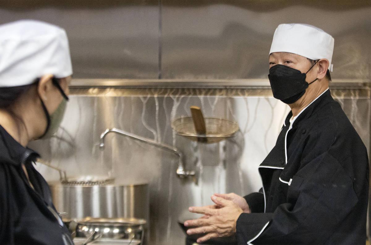 Po Fai Lam, master chef at Chinglish Cantonese Wine Bar, communicates with kitchen staff on Thu ...