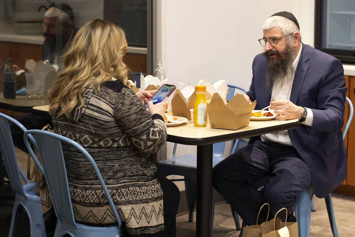Chaya Harlig, left, and Rabbi Mendy Harlig enjoy a meal at Kosher Chinglish, sister restaurant ...
