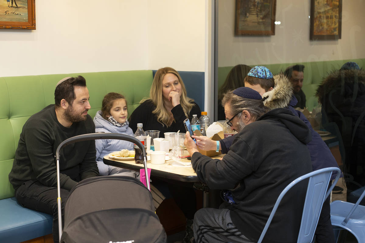 The Gottlieb family, of New York, enjoy a meal at Kosher Chinglish, sister restaurant of Chingl ...