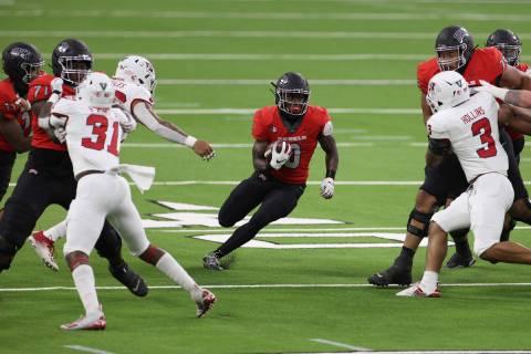 UNLV Rebels running back Charles Williams (8) runs the ball against the Fresno State Bulldogs d ...