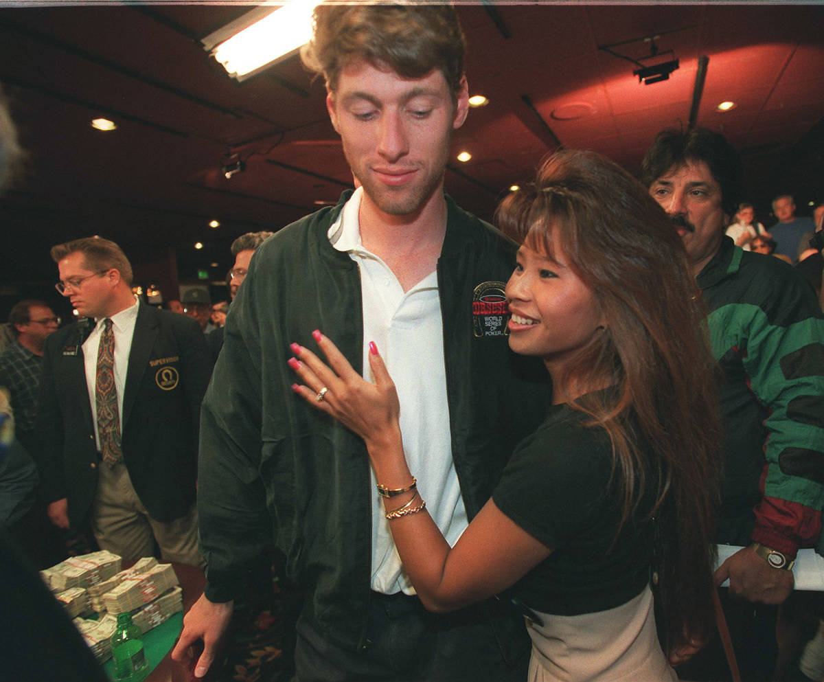 Huck Seed gets a hug from his girlfriend after winning the World Series of Poker on May 16, 199 ...