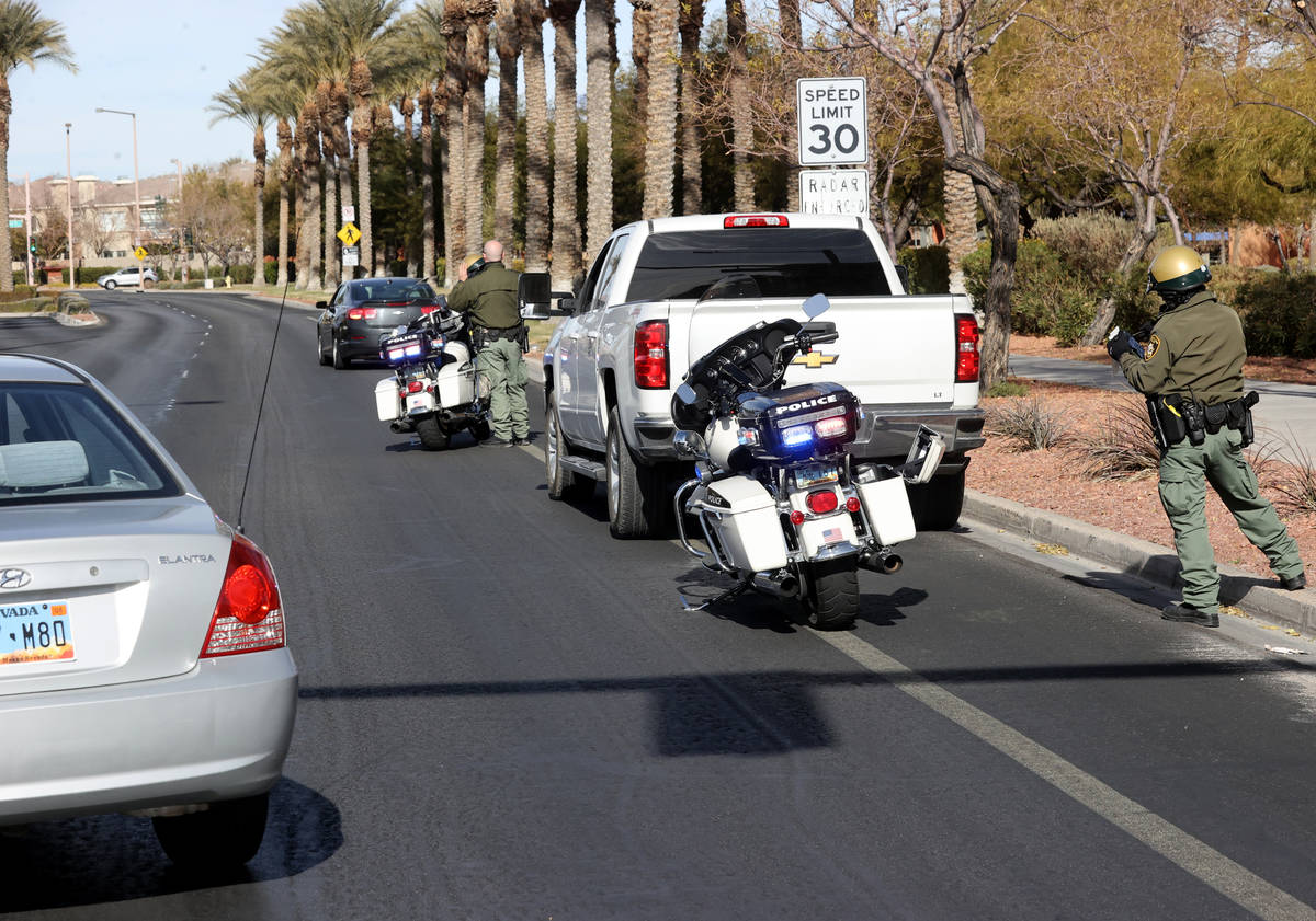Las Vegas police officers B. Layne, left, and J. Quintana pull over motorists during an enforce ...