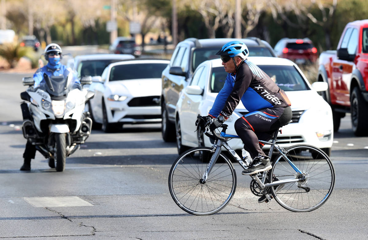 A cyclist rides across West Charleston Boulevard in Las Vegas in front of a North Las Vegas Pol ...