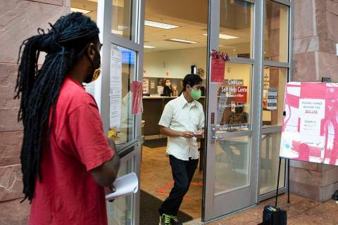 Kenyaday Fitzgerald stand in line outside of the Civil Law Self-Help Center, operated by Legal ...