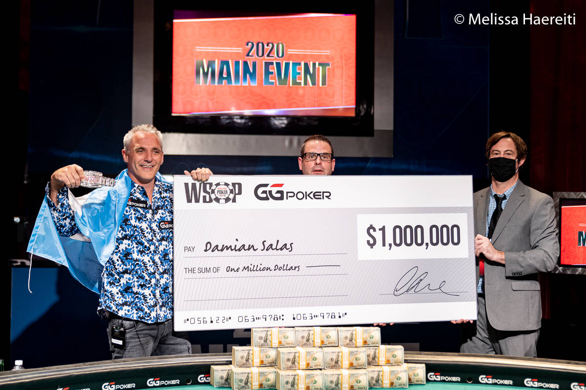 Damian Salas shows off his $1 million check for winning the World Series of Poker Main Event ti ...