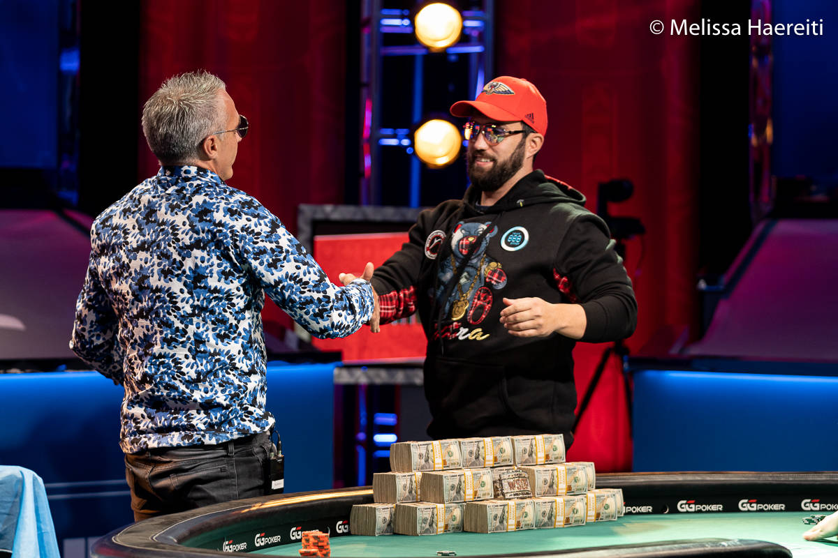 Damian Salas, left, and Joseph Hebert embrace after Salas won the World Series of Poker Main Ev ...