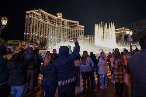 A crowd watches the Fountains at Bellagio on the Strip, Friday, Nov. 27, 2020, in Las Vegas. (E ...