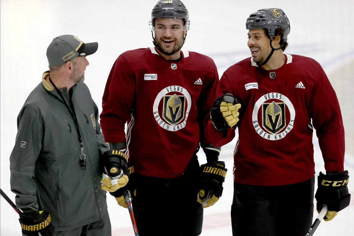 Golden Knights Coach Pete DeBoer, from left, forward William Carrier and forward Ryan Reaves on ...