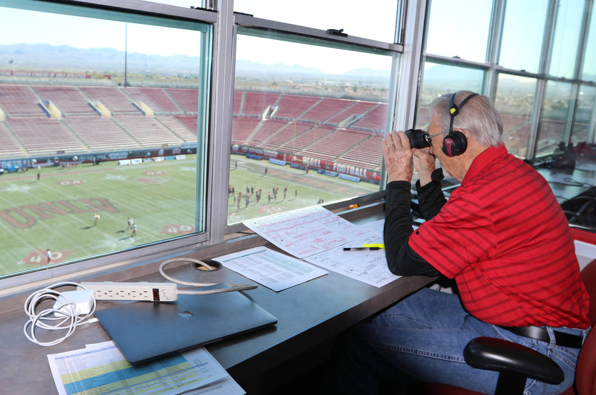 "The ""Voice of the Rebels"", Dick Calvert, looks out to the field at Sam Boyd Stadium p ..."