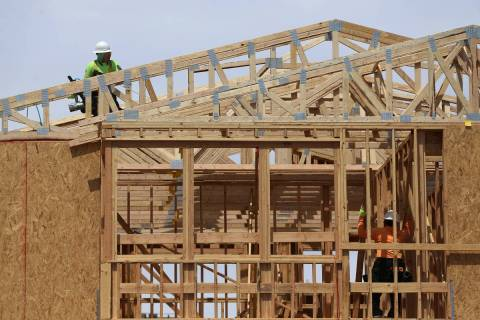 Workers on the roof of a new home construction in Skye Canyon community in Las Vegas, Thursday, ...