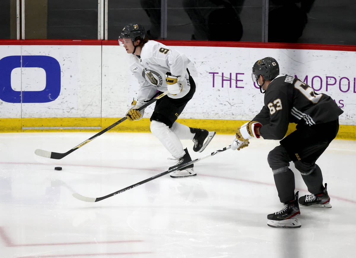 Golden Knights center Cody Glass (9) moves the puck past defenseman Carl Dahlstrom (63) during ...