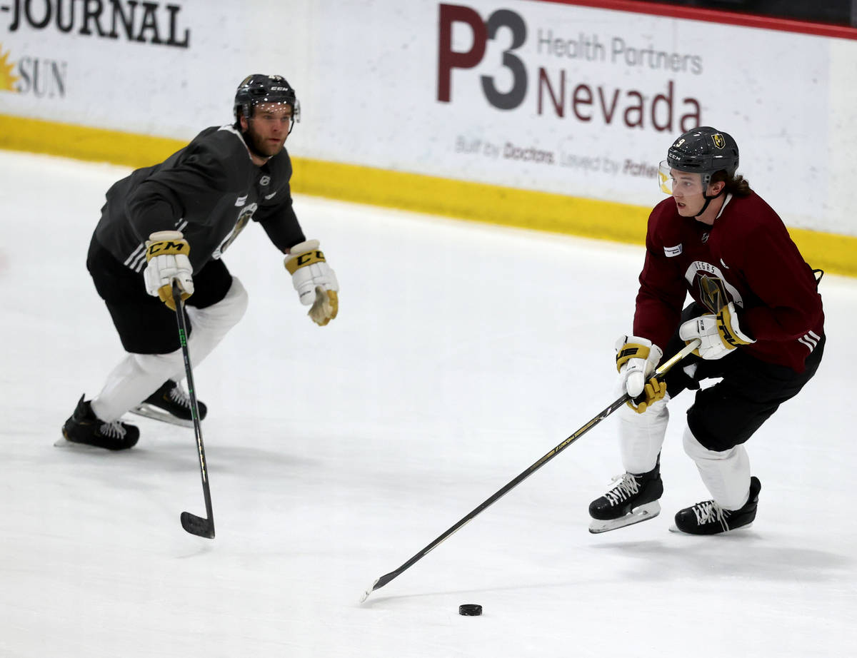 Golden Knights center Cody Glass (9) moves the puck past defenseman Jake Bischoff (45) during t ...