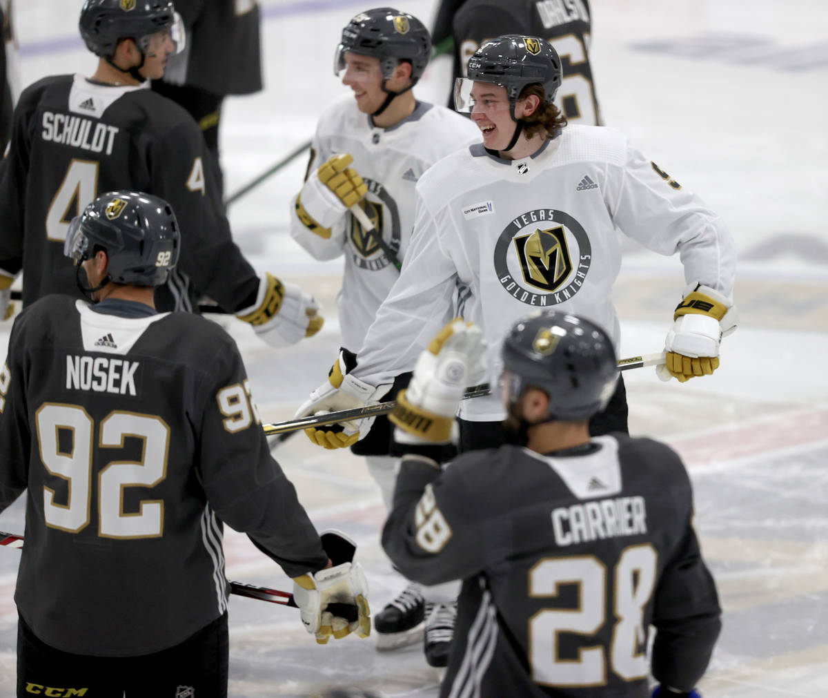 Golden Knights center Cody Glass (9) shares a laugh with teammates during training camp at City ...