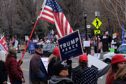 A few hundred Trump supporters gathered Wednesday outside the Legislative Building in Carson Ci ...