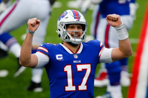 Buffalo Bills quarterback Josh Allen (17) reacts after throwing a touchdown pass in the first h ...