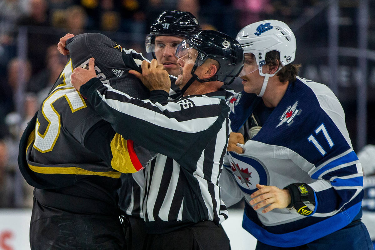 Vegas Golden Knights right wing Ryan Reaves (75) gets help with his jersey from a linesman afte ...