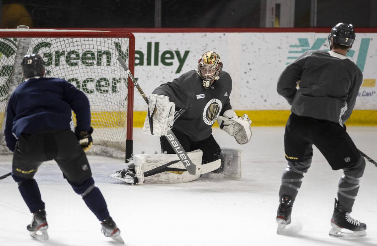 Golden Knights goaltender Robin Lehner (90) tracks the puck during practice at City National Ar ...