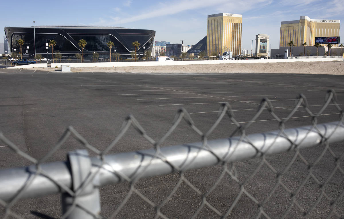Allegiant Stadium and the Las Vegas Strip are seen from the parking lot on the corner of Russel ...