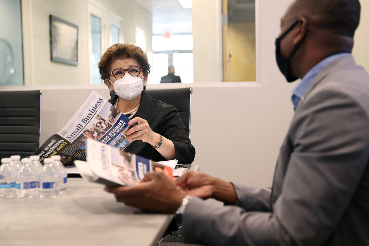 Jovita Carranza, left, Administrator of the U.S. Small Business Administration, speaks with Ren ...