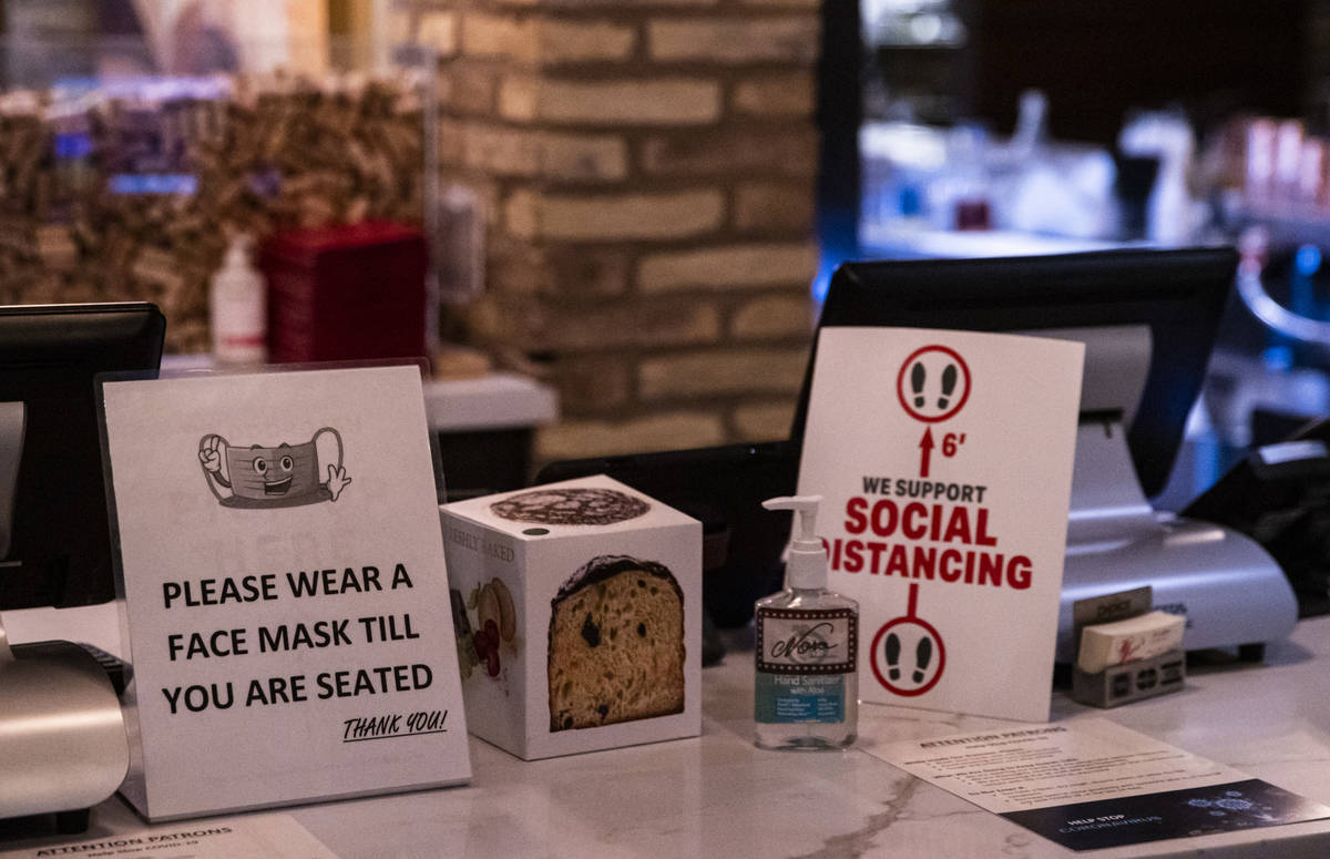 Signs at Nora's Italian Cuisine indicate some of the steps the restaurant is taking to help pre ...