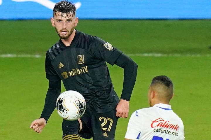 Los Angeles FC defender Tristan Blackmon (27) passes the ball over Cruz Azul midfielder Orbelin ...