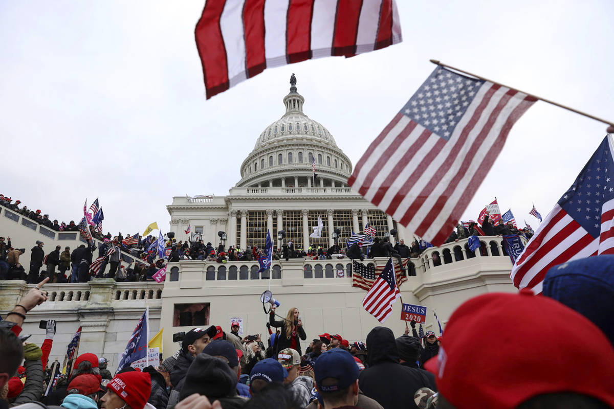 In this Wednesday, Jan. 6, 2021, file photo, supporters of President Donald Trump gather outsid ...