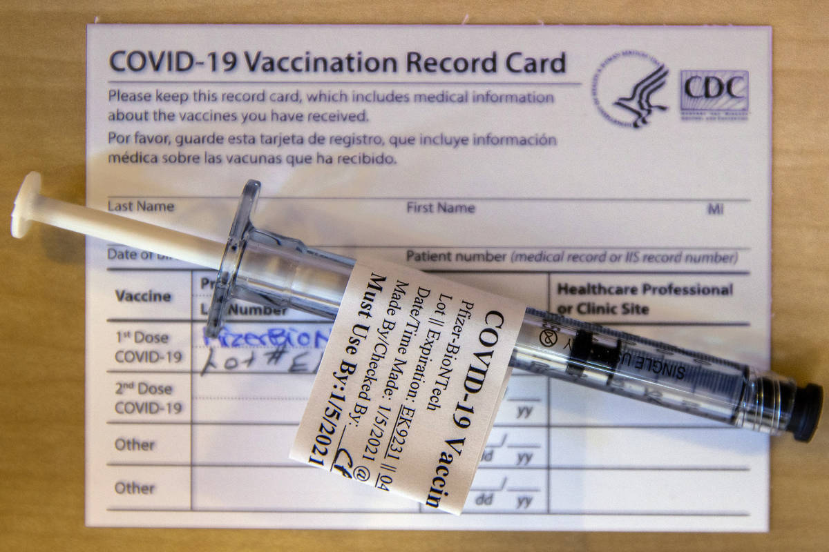 A pre-loaded shot and record card as some of the first veterans locally get their COVID-19 vacc ...
