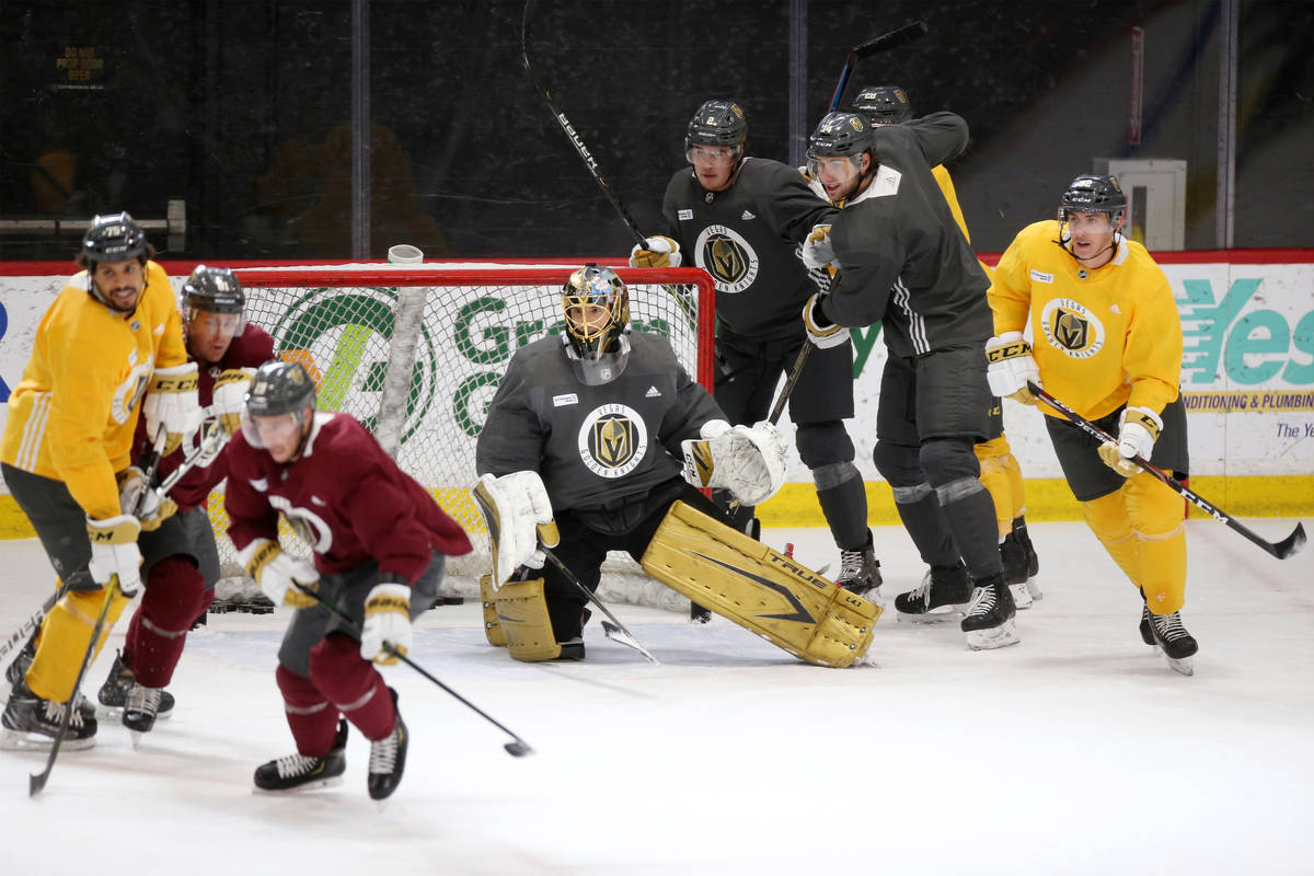 Vegas Golden Knights goaltender Marc-Andre Fleury, center, is seen with his teammates during a ...