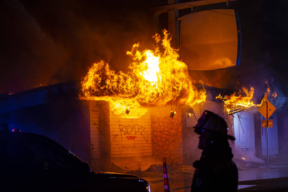 Las Vegas firefighters battle flames engulfing a vacant wedding chapel at 1431 S. Las Vegas Blv ...