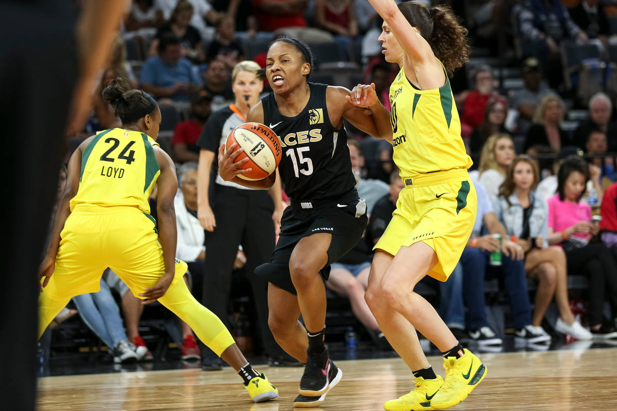 Las Vegas Aces guard Lindsay Allen (15) goes to the basket against Seattle Storm guard Sue Bird ...