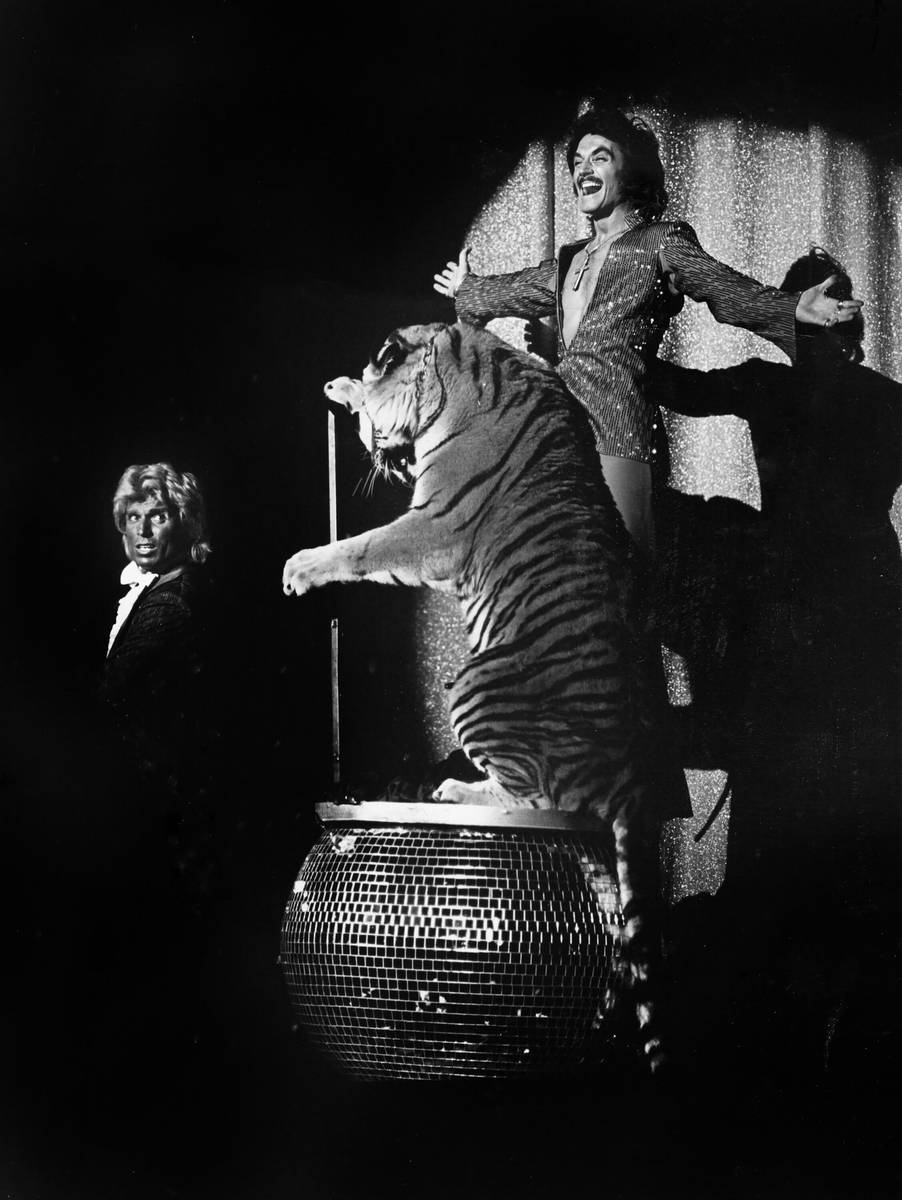 This undated file photo shows Siegfried Fischbacher, left, and Roy Horn perform with a tiger. ( ...
