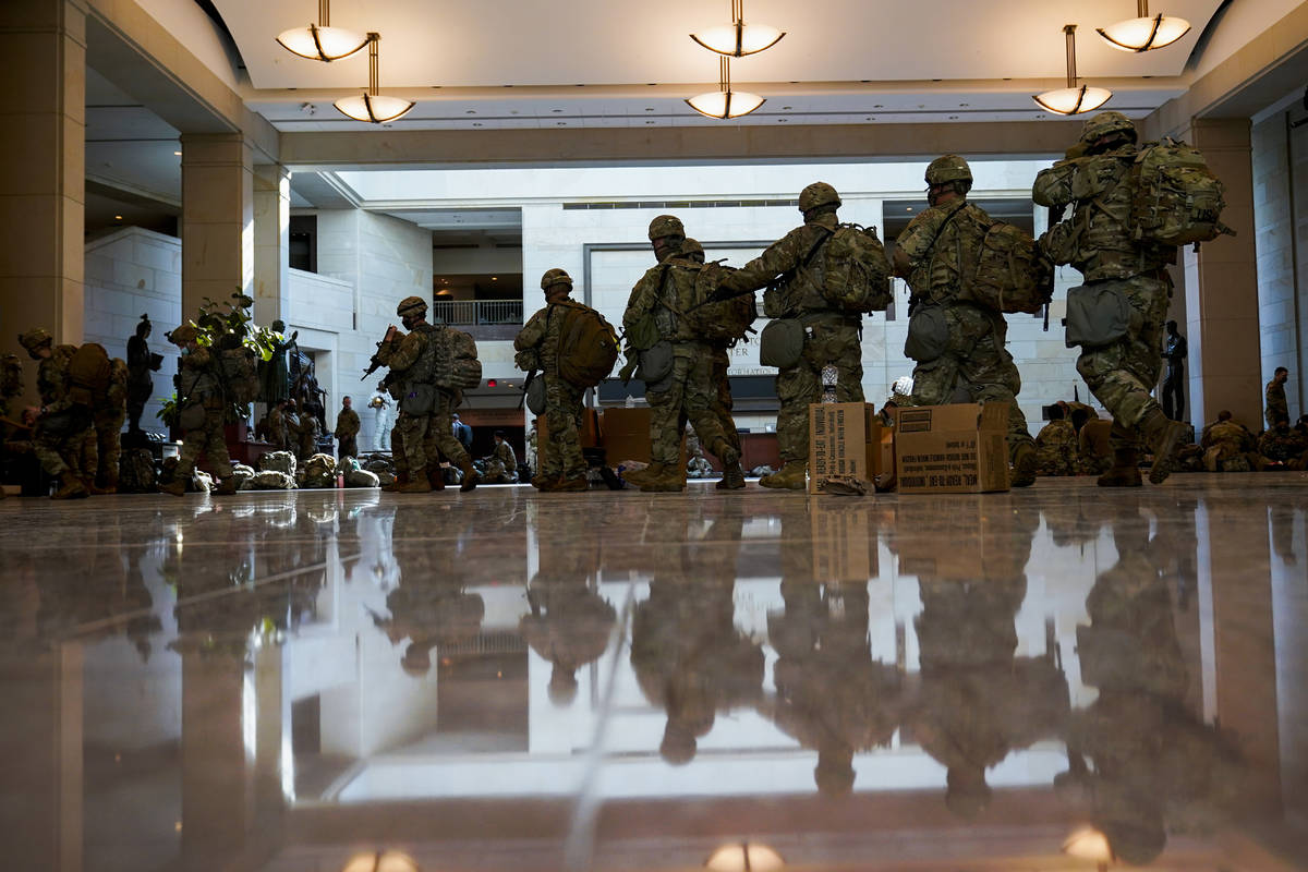 Troops move inside the Capitol Visitor's Center to reinforce security at the Capitol in Washing ...