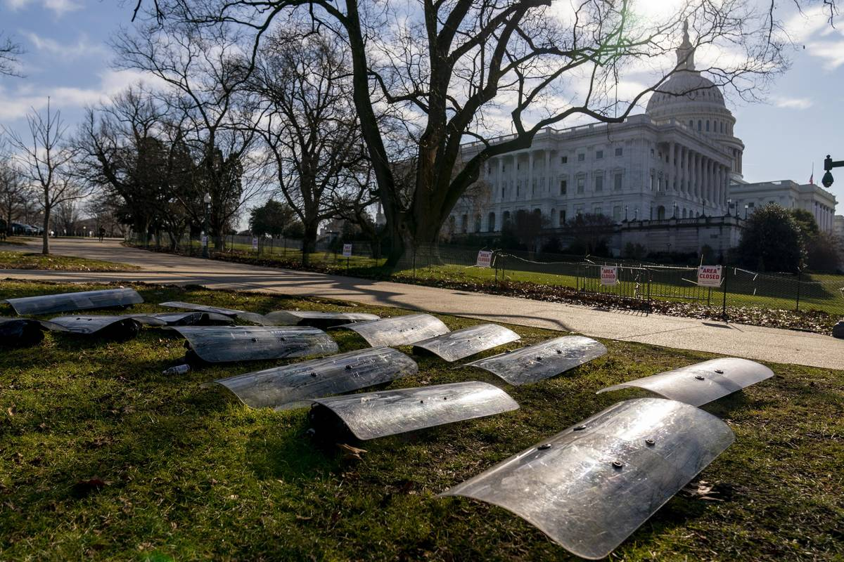 The Dome of the Capitol building is visible as riot gear is laid out on a field on Capitol Hill ...