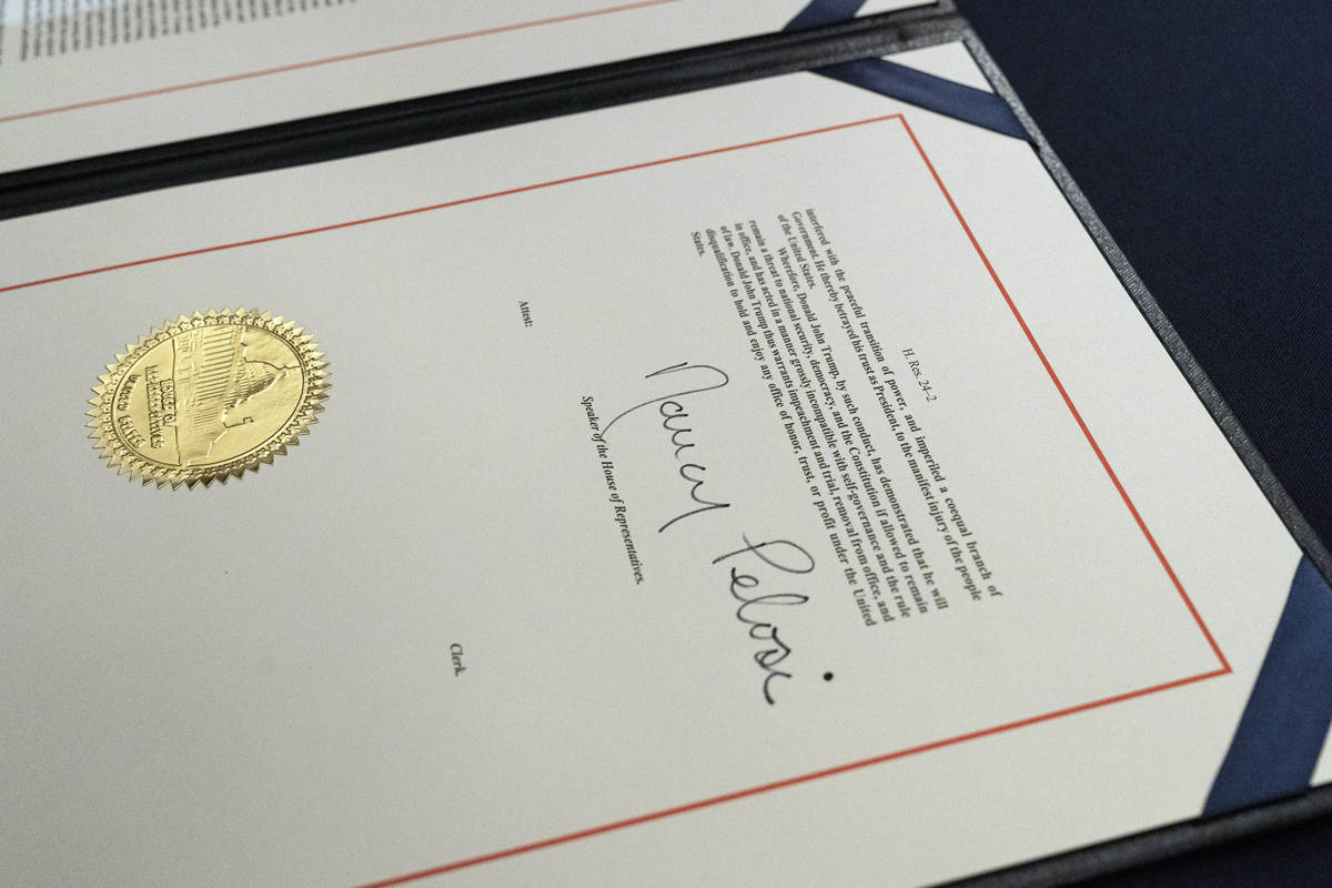 The signature of House Speaker Nancy Pelosi of Calif., is on the article of impeachment against ...