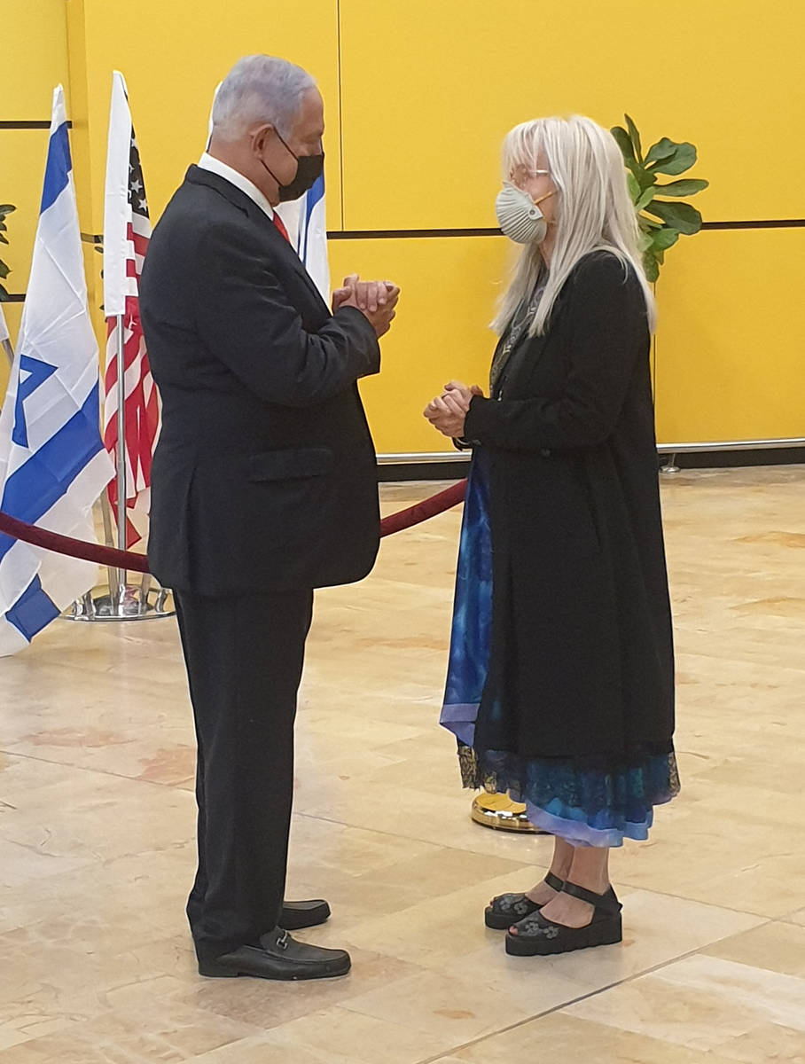 Israeli Prime Minister Benjamin Netanyahu, left, offers his condolences to Dr. Miriam Adelson o ...