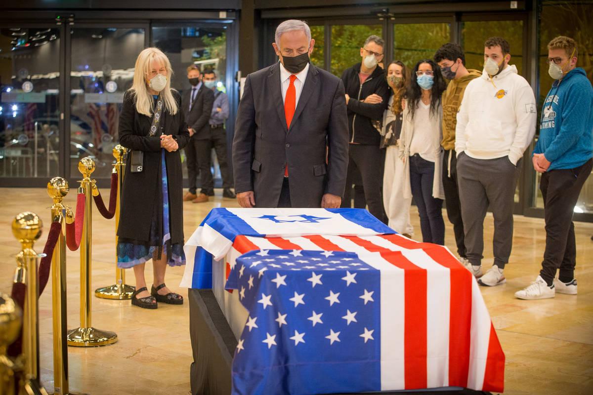 Israeli Prime Minister Benjamin Netanyahu pays his respects to Sheldon Adelson on Thursday, Jan ...
