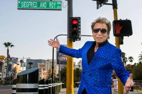 Siegfried Fischbacher watches while the Mirage porte cochere is renamed Siegfried & Roy Drive i ...