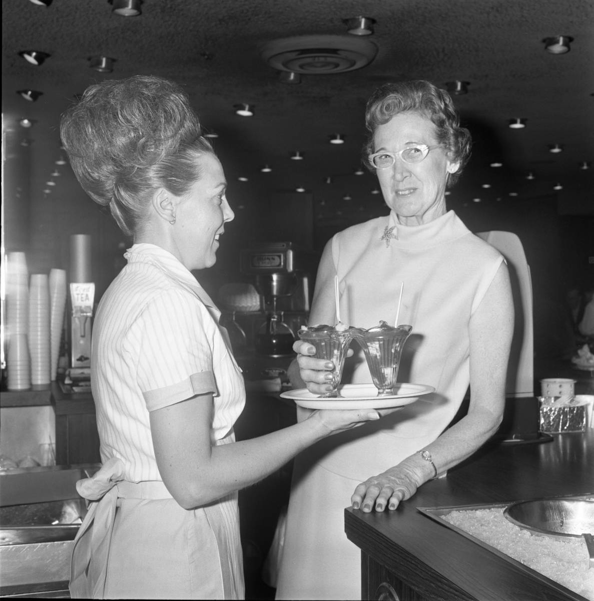 Waitress Gladys Reed, left, and Johnnie Wilson holding the famous Golden Gate shrimp cocktail i ...