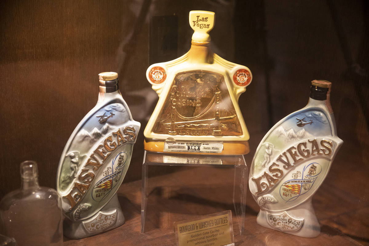 Bourbon and whiskey bottles from the 1950s are displayed at Golden Gate hotel-casino in Las Ve ...