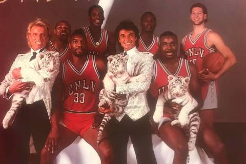 Magicians Siegfried & Roy and their white tiger pups shared the cover of the 1986-87 UNLV baske ...