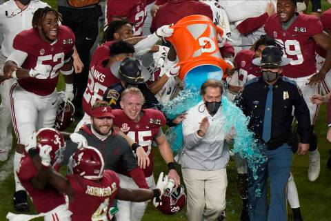 Alabama head coach Nick Saban is soaked in a sports drink after their win against Ohio State in ...