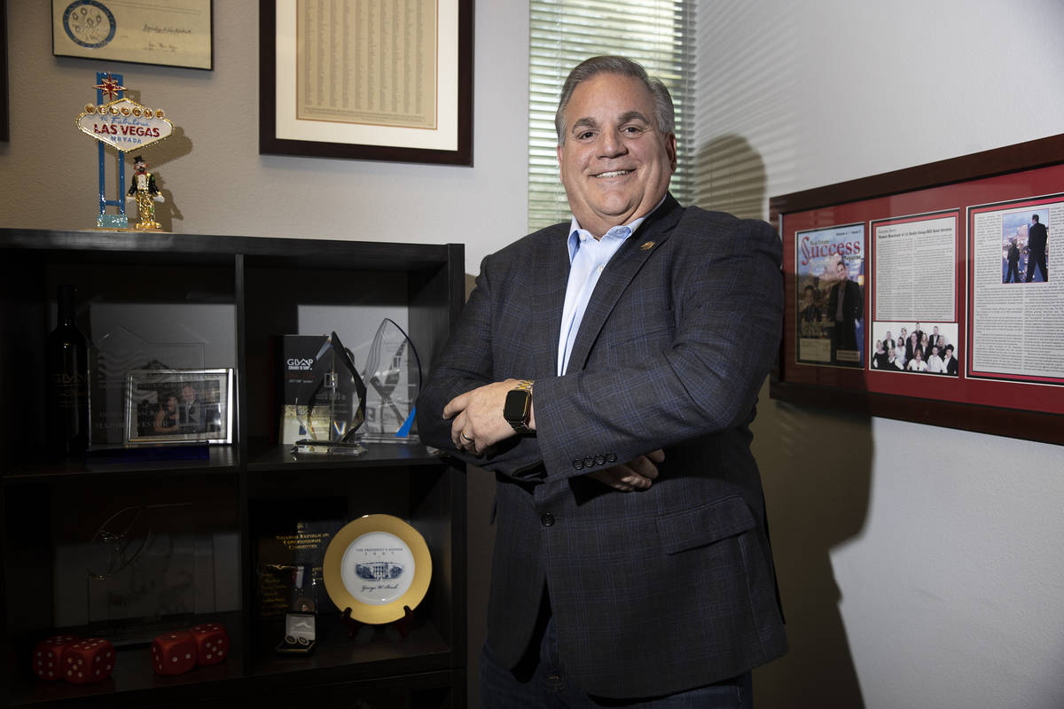 Thomas Blanchard, managing broker for Signature Real Estate Group, poses for a portrait at his ...