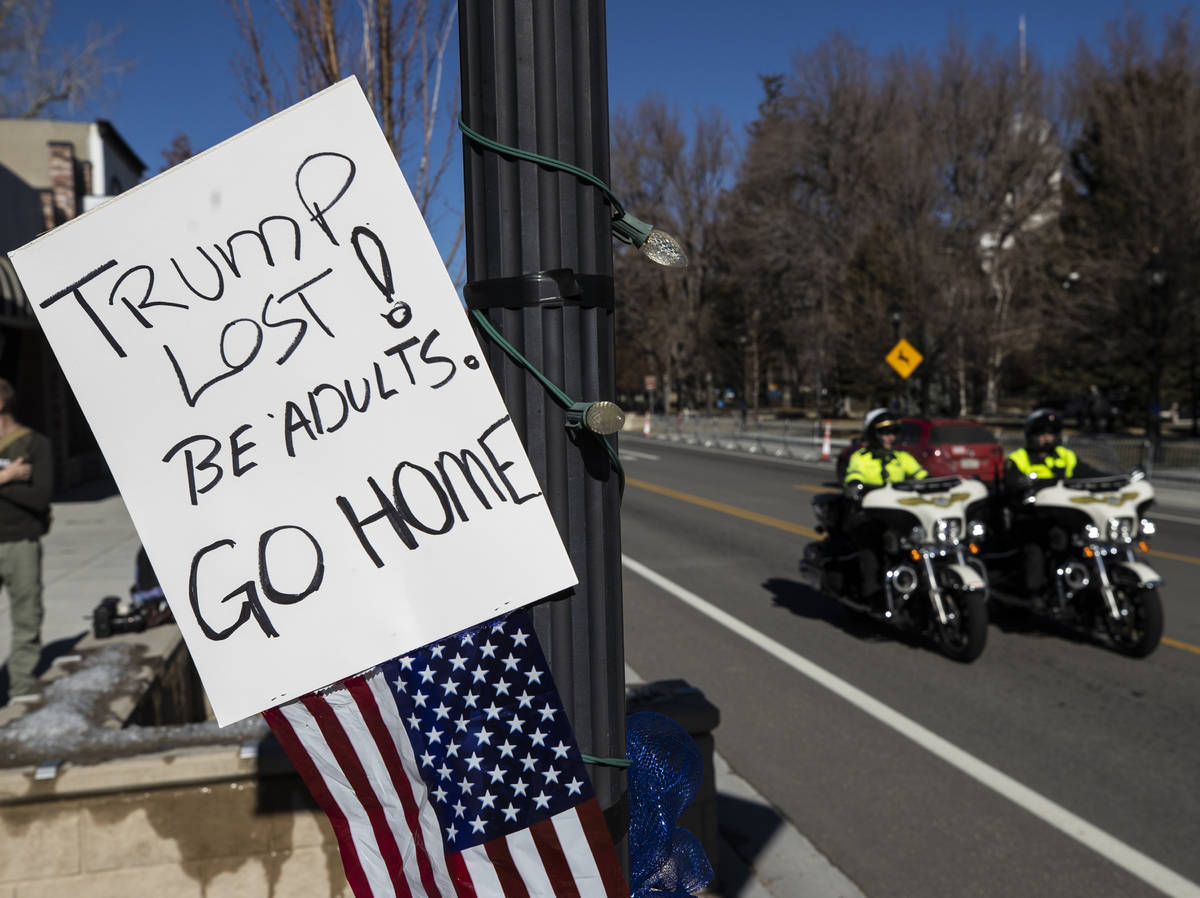Law enforcement patrol the state Capitol complex on Sunday, Jan. 17, 2021, in Carson City, Nev. ...