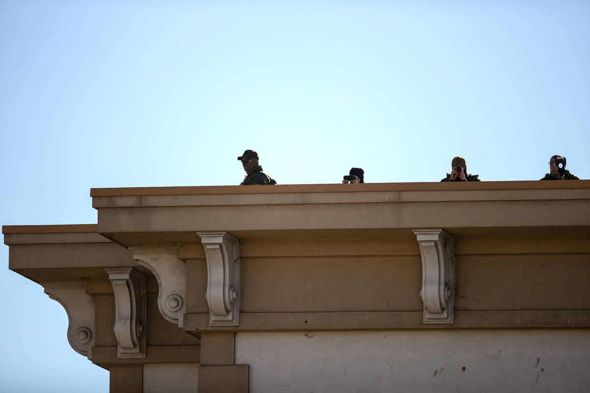 Law enforcement keep watch over the state Capitol complex on Sunday, Jan. 17, 2021, in Carson C ...